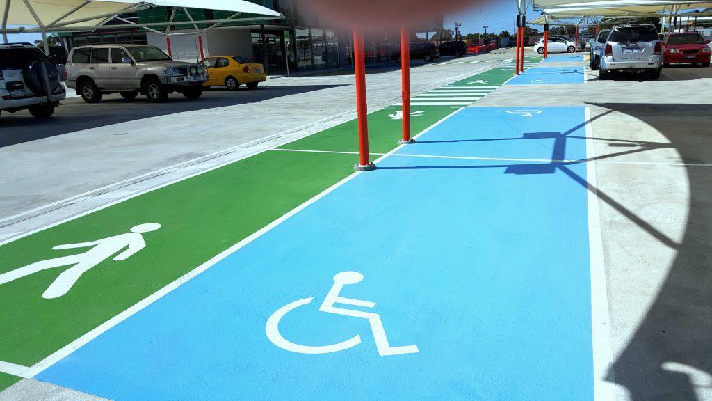 Disabled carpark markings and green walkway